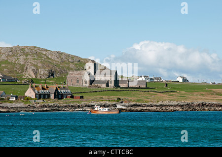View of Iona village and abbey from the sea, Isle of Iona, Argyll & Bute (Inner Hebrides), Scotland, UK, Western - Stock Photo