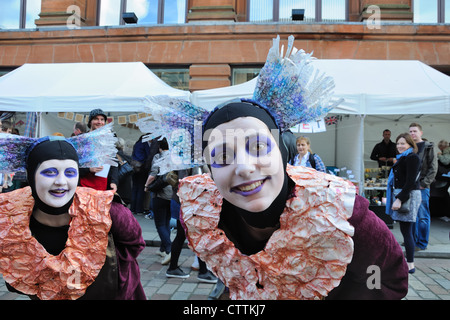 Street performers at the Merchant City Festival in Glasgow City centre - Stock Photo
