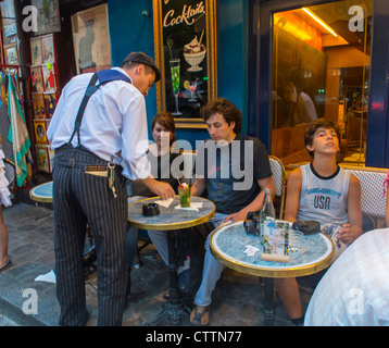 Paris, France, French Waiter, Serving Tables, Outside with Tourists in Parisian Café, Terrace, in the Butte Montmartre - Stock Photo