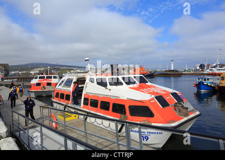Landing craft arriving in harbour from Caribbean Princess cruise ship visiting Kirkwall, Orkney Mainland, Scotland, - Stock Photo