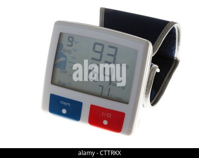 Personal home blood pressure monitor with wristband showing low systolic diastolic and heart rate values on LCD - Stock Photo