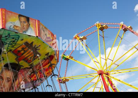 traditional fairground rides - Stock Photo