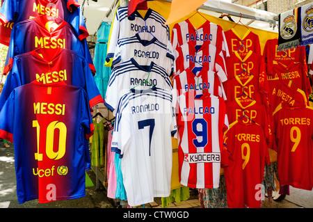 Scene shirts football Spain, from El Rastro flea market in Madrid Spain. - Stock Photo
