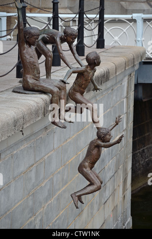 A sculpture at Cavenagh Bridge near the Fullerton Hotel, Singapore. - Stock Photo