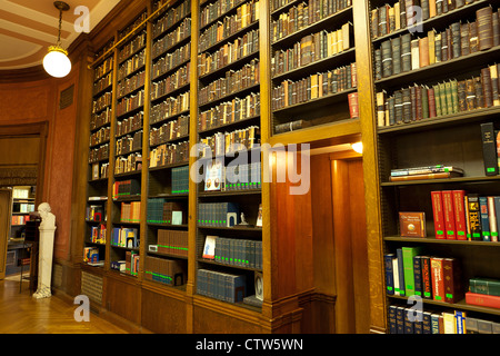 Old books on shelves in a vintage library  - USA - Stock Photo