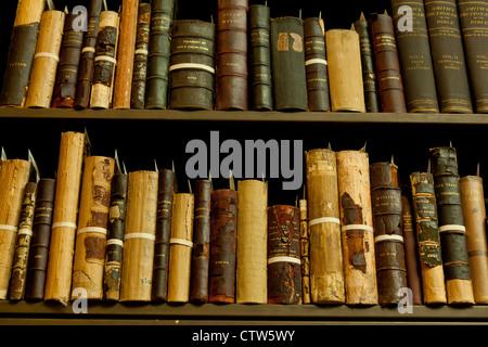 Antique books on shelf - Stock Photo