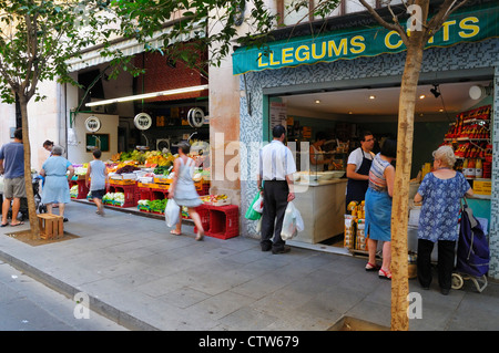 People shopping for fresh products in the small stores in Barcelona, Spain.