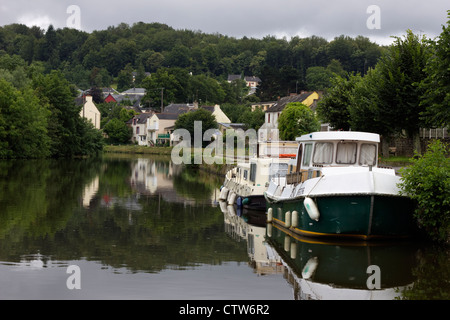 Boats moored at Malestroit on the River Oust - Stock Photo