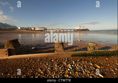 The beach at Eastbourne in East Sussex, England, UK at low tide. Showing the pier in the distance. - Stock Photo