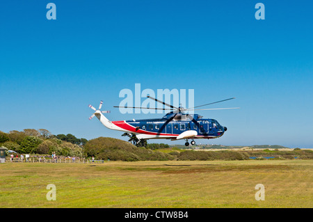 British International Helicopter taking off from Tresco, Scillies. NOTE: this service ended October 2013 - Stock Photo