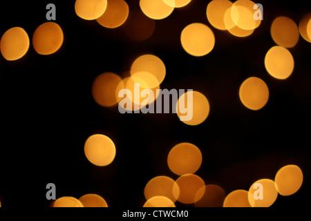 Glowing lights at night, bokeh background - Stock Photo