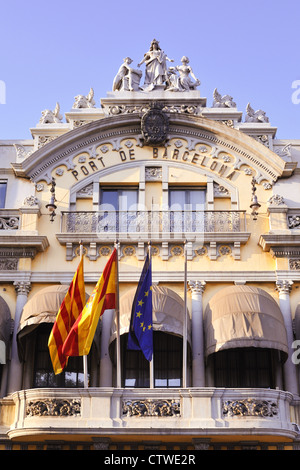 historic building of famous Barcelona port with Spanish, Catalan and European Union Flags on it - Stock Photo