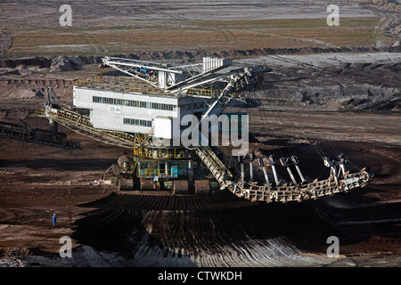 Brown coal / lignite being extracted by huge bucket-wheel excavator at open-pit mine, Saxony-Anhalt, Germany - Stock Photo