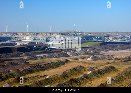 Spoil heaps and brown coal / lignite being extracted by huge bucket-wheel excavators at open-pit mine, Saxony-Anhalt, - Stock Photo