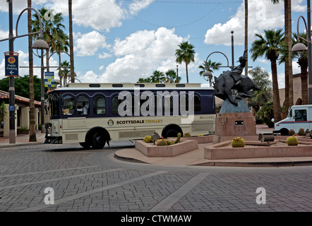 Free Old Town Scottsdale AZ downtown 'hop on hop off' trolley bus service in traffic circle roundabout - Stock Photo