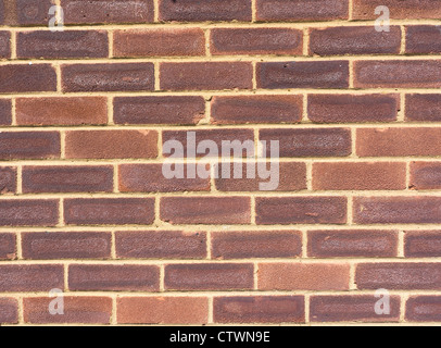 Close on a section of a brick wall facade - Stock Photo