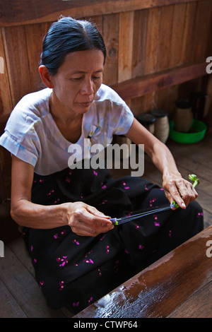 The making of LOTUS SILK from the stalks of the lotus plant is a local industry of INLE LAKE - MYANMAR - Stock Photo
