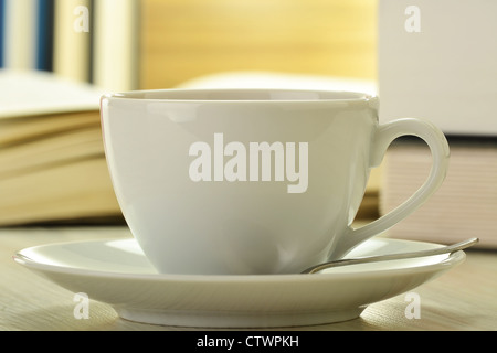 Composition with books and cup of coffee on the table - Stock Photo