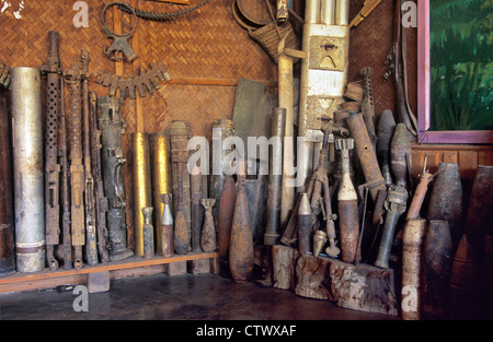 Display of War Scrap Metal including US Cluster Bombs and Missiles Dropped During the Vietnam War at Phonsavan Laos - Stock Photo