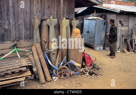 War Scrap US Cluster Bombs & Missiles from Vietnam War in Scrap Metal Yard Phonsavan Xieng Khuang Laos - Stock Photo