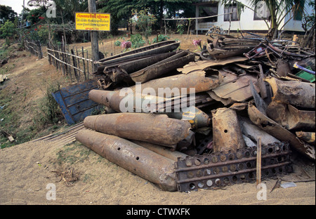 Scrap Metal of US Phonsavan Cluster Bomb Cases from Vietnam War Piled Up in Scrap Yard in Phonsavan Laos - Stock Photo