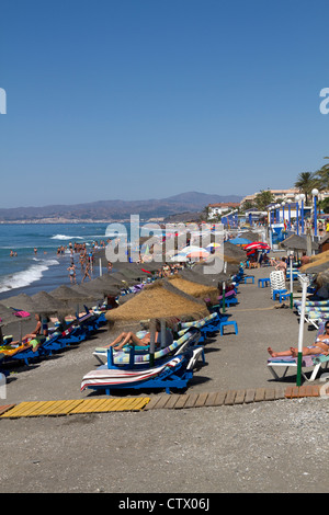 Crowded beach on the Playa Ferrara Torrox Spain - Stock Photo