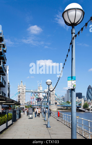 View of Tower Bridge decorated with the Olympic Rings from Butler's Wharf, Shad Thames, Bermondsey, London, UK. - Stock Photo