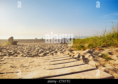 Early morning at a Maine beach in summer, chairs placed to reserve a good spot - Stock Photo