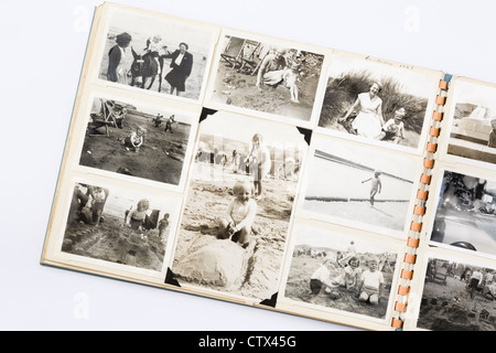 Old faded black and white printed photographs in a family photograph photo album from 1950s era with page showing - Stock Photo