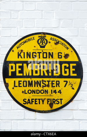 Antique AA Road sign on a white brick wall. Pembridge. Herefordshire. England - Stock Photo
