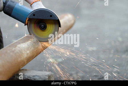 Cutting metal angle grinder, sparks from the disk. Photo close-up - Stock Photo