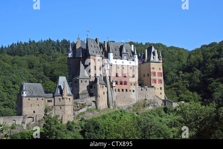 Castle Burg Eltz nestled amongst the hills and forest in the Eltz Valley Rhineland-Palatinate Germany Europe - Stock Photo