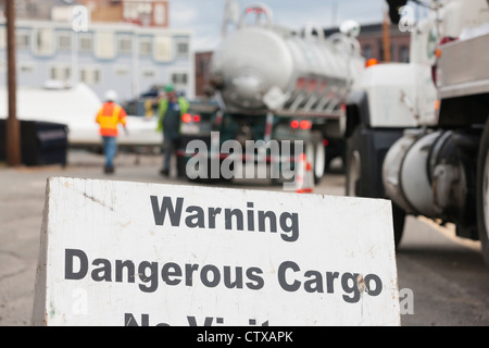 Warning Dangerous Cargo sign at hazardous waste cleanup site - Stock Photo