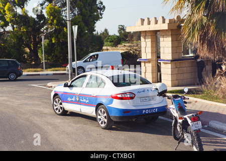 A police car on the road to Tunisia, Africa - Stock Photo
