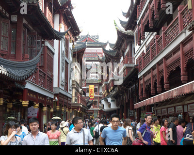 View of shoppers in a shopping street in the Yuyuan Market area in Shanghai China - Stock Photo