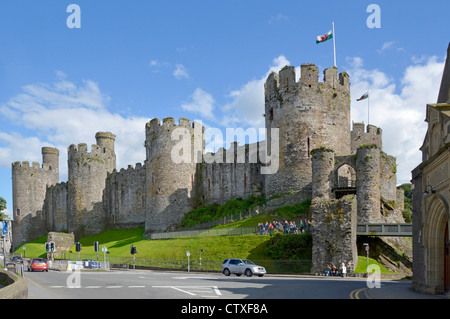 Wales dragon flag over ruins of massive defensive walls of Medieval Conwy Castle in Conway town  in Conwy County - Stock Photo