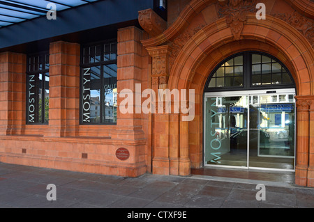 Oriel Mostyn Art Gallery entrance with part of its red brick and terracotta façade Llandudno Conwy County Borough - Stock Photo