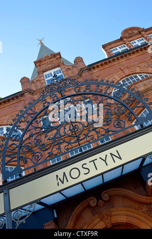 Oriel Mostyn Art Gallery modern & older signs above entrance with red brick and terracotta façade Llandudno Conwy - Stock Photo