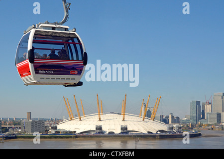 View of The 02 o2 arena dome from inside Emirates Air Line sponsored cable car cabin crossing River Thames with - Stock Photo