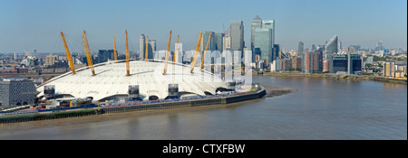 Aerial view of the o2 arena 02 millenium dome with River Thames and Canary Wharf skyline - Stock Photo