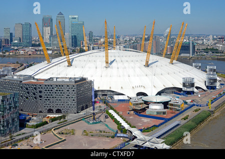 Aerial view O2 dome arena London 2012 Olympic venue on the Greenwich Peninsula with Canary Wharf banking skyline - Stock Photo