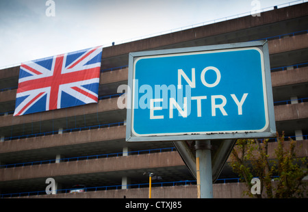 A No Entry sign at a multi storey car park which is displaying a giant Union Jack flag, Redditch, Worcestershire, - Stock Photo