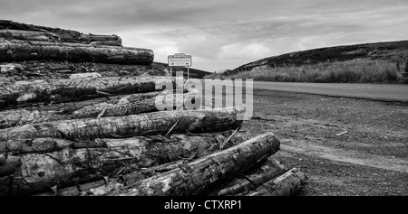 timber stack with northumberland sign in background - Stock Photo