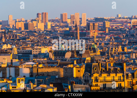 Paris, France, Parisian Rooftops and Skyline From Montmartre Hill, Looking to East at Sunset - Stock Photo