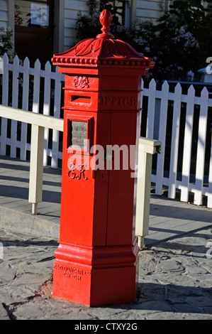 A Victorian post box next to the to the post office still in service today in Arrowtown, Otago,New Zealand - Stock Photo