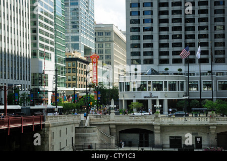 Chicago's State Street bridge. Renaissance Hotel on right. Chicago Theater sign. - Stock Photo