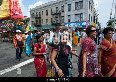 Hundreds of members of the Hare Krishna religion march in their annual Ratha Yatra parade. - Stock Photo