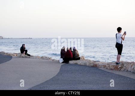 Beach scene along the seaside promenade in Tel Aviv, Israel - Stock Photo