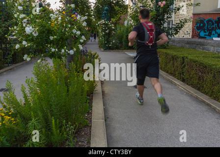 Paris, France, Man Jogging on Pathway in 'Promenade Plantée' park, Urban Garden Landscaped city people - Stock Photo