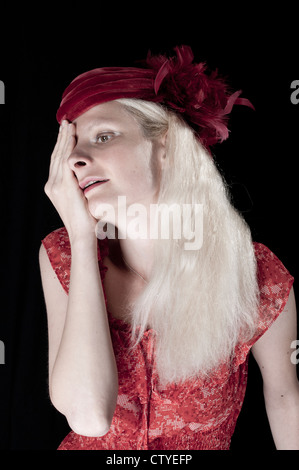 Young woman covering her eye with her hand - Stock Photo